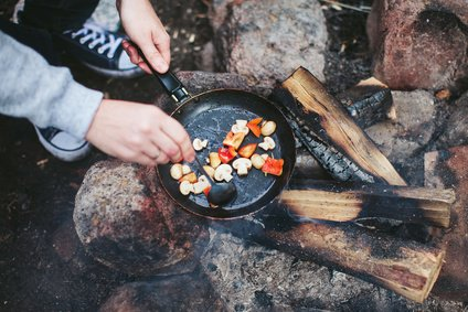 Cooking Mushrooms Over Campfire